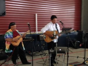 Mick Angeles and Vic Kena perform at the Brisbane Basket Brigade packing day 2016